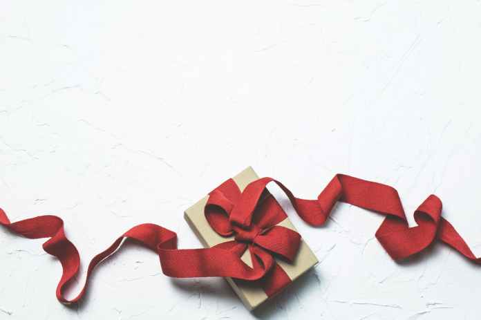 red and white gift box with ribbon bow
